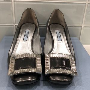 Prada heels with silver buckle